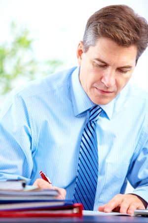 person writing: Businessman working with documents in the office