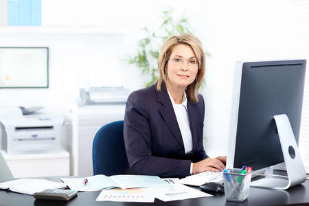 accountants: Pretty business woman working in the office