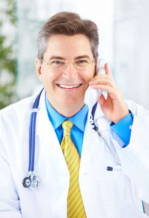Medical doctor calling by phone in the office  photo