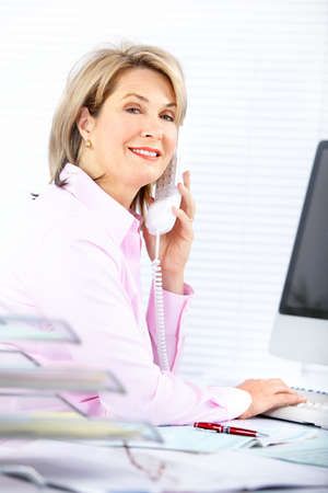 Pretty business woman working in the office Stock Photo - 8255747