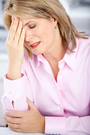 tired businessman: business woman  having stress in the office  Stock Photo