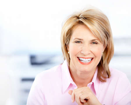older women: Happy business woman in the office  Stock Photo
