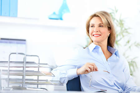 Pretty business woman working in the office Stock Photo - 8255679