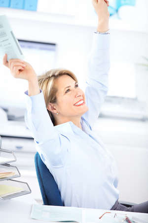 Happy  business woman in the office  photo