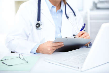 doctor laptop: Medical doctor woman in the office  Stock Photo