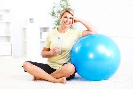 woman sport: Fitness woman with a bottle of spring water  Stock Photo