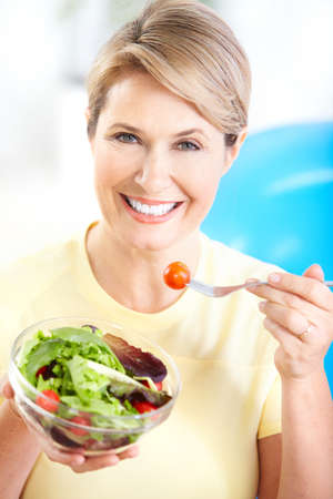 Mature smiling woman  with fruits and vegetables.   photo