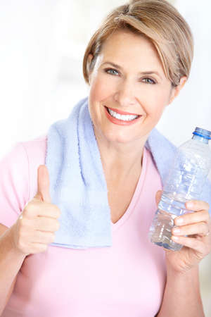 Fitness woman with a bottle of spring water  Banco de Imagens
