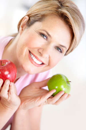 Mature smiling woman with apples  photo