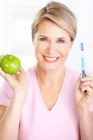 Beautiful mature woman with a toothbrush.   photo