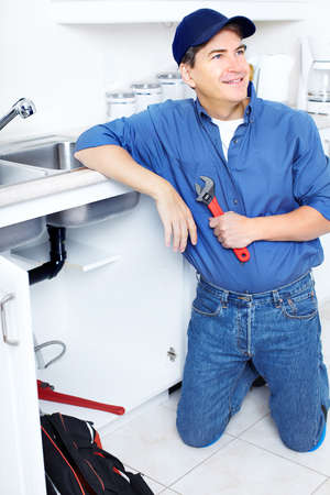 Mature plumber fixing a sink at kitchen Stock Photo - 8255799