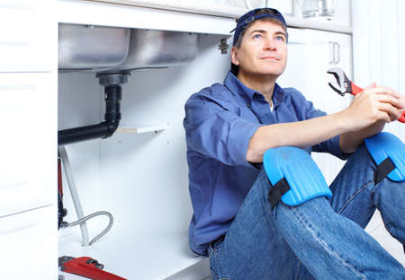 Mature plumber fixing a sink at kitchen Stock Photo - 8255767