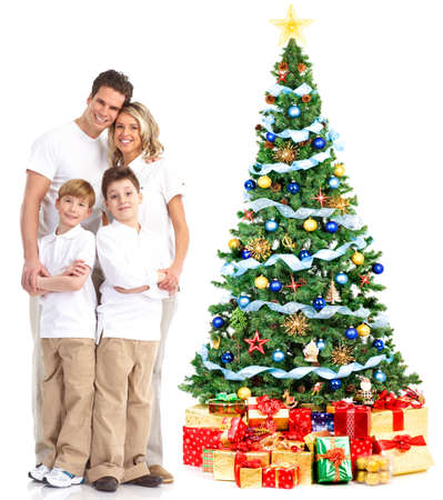 Family and a Christmas Tree. Over white background Stock Photo - 8255847