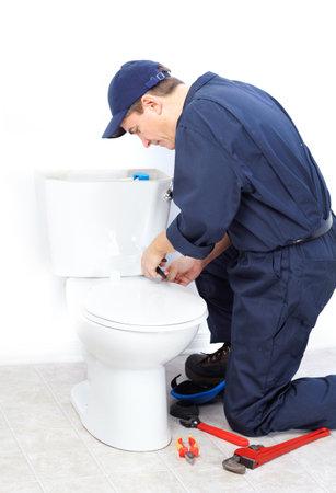 Mature plumber near a flush toilet  Stock Photo - 8255830