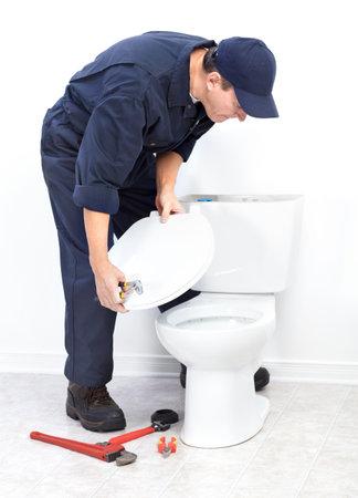 Mature plumber near a flush toilet Stock Photo - 8255827