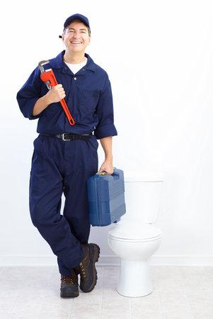 janitor: Mature plumber near a flush toilet