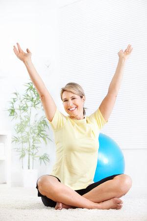 exercitation: Gym & Fitness. Smiling elderly woman.   Stock Photo