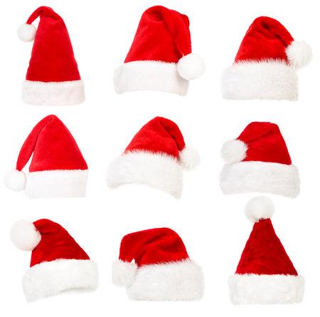 Set van Santa hoeden. Geïsoleerd op witte achtergrond Stockfoto