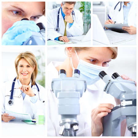 lab technician: Woman working with a microscope in a lab  Stock Photo