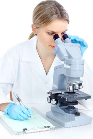 Woman working with a microscope in lab  photo