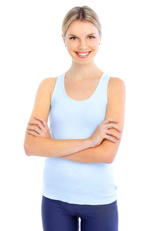 Fitness and gym. Smiling young  woman. Isolated over white background  Фото со стока