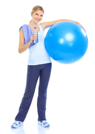 exercitation: Fitness and gym. Smiling young  woman. Isolated over white background  Stock Photo