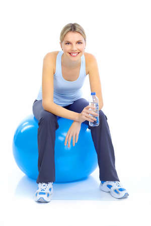 muscularity: Fitness and gym. Smiling young  woman. Isolated over white background  Stock Photo