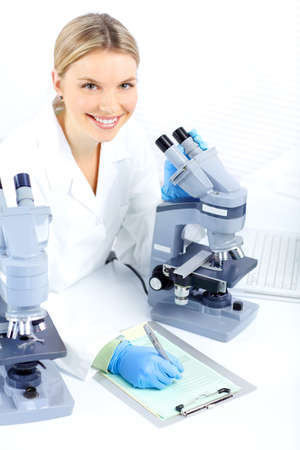 laboratorian: Woman working with a microscope in lab