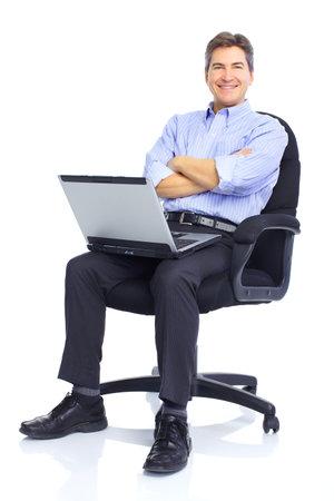 edad media: el hombre de negocios trabajan con ordenador port�til. Sobre fondo blanco