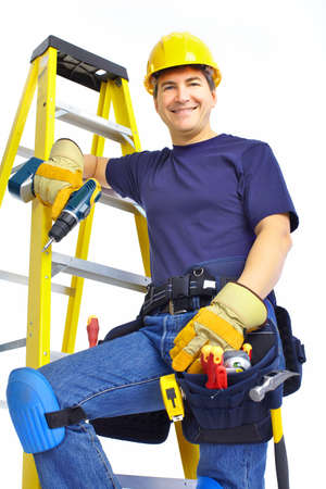 Handsome smiling builder. Isolated over white background