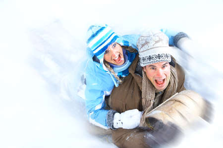 Young  happy smiling couple sledging. Winter  photo
