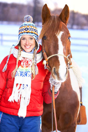 winter woman: Young  happy smiling woman with horse. Winter sport