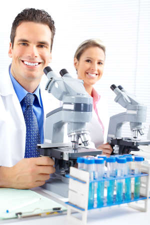 laboratorian: Team working with microscopes in a laboratory  Stock Photo