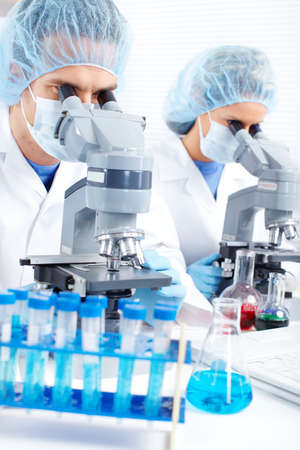 Team working with microscopes in a laboratory Stock Photo - 8347587