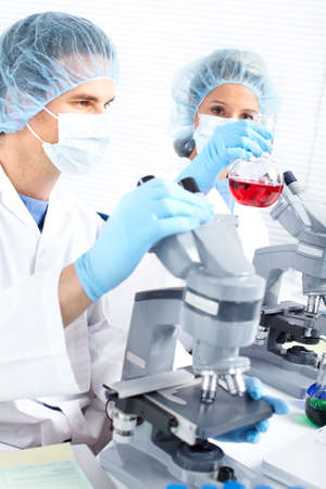 Team working with microscopes in a laboratory  Stock Photo