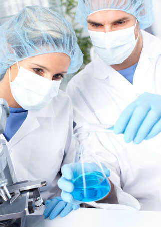 lab technician: Team working with microscopes in a laboratory  Stock Photo