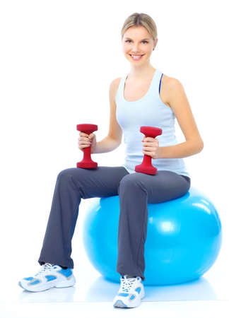 Fitness and gym. Smiling young  woman. Isolated over white background Banque d'images