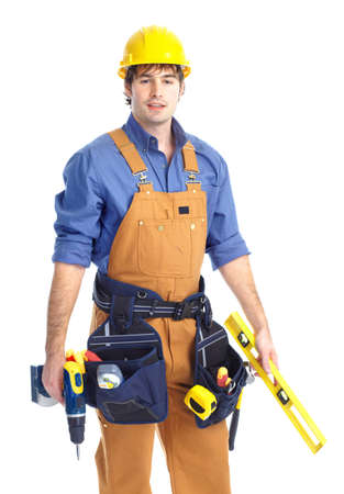 contractors: Young handsome contractor in yellow uniform. Isolated over white background