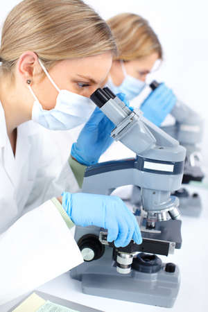 Women working with a microscope in a lab