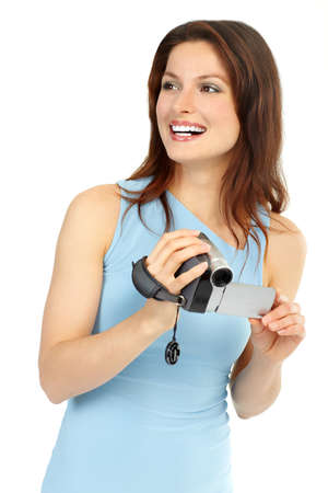 Young woman with camcorder. Isolated over white background  photo