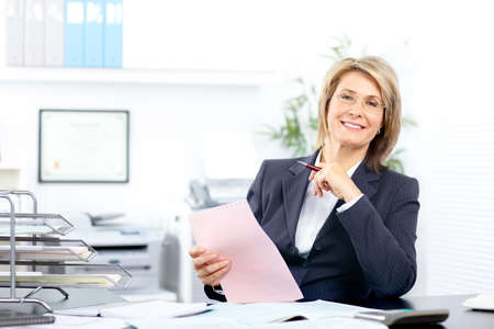 business woman: Pretty business woman working in the office