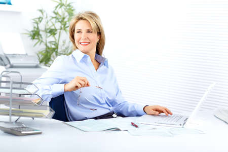 working woman: Pretty business woman working in the office