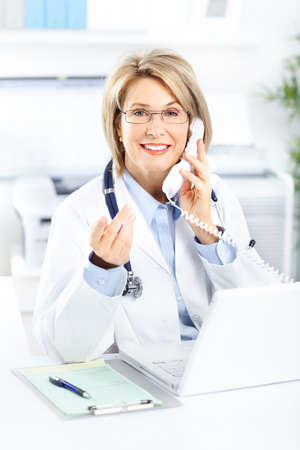 medical practice: Medical doctor woman in the office  Stock Photo