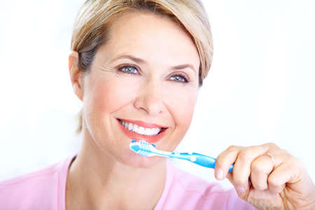 Beautiful mature woman with a toothbrush. Stock Photo - 8430715