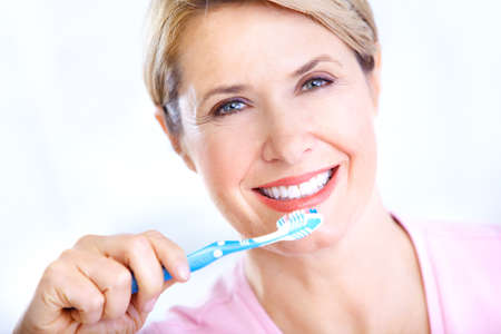 Beautiful mature woman with a toothbrush. 