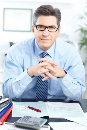 Handsome businessman working in the office  photo