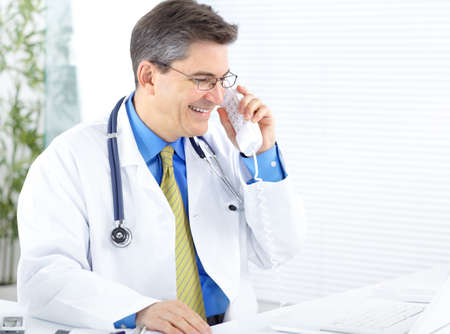 Medical doctor working with laptop in the office  photo