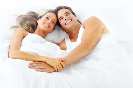 Young happy couple in bed  Imagens