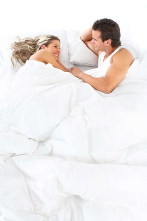 bedroom: Young happy couple in bed  Stock Photo