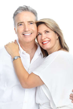 Happy seniors couple in love. Healthy teeth. Isolated over white background Stock Photo - 8555067